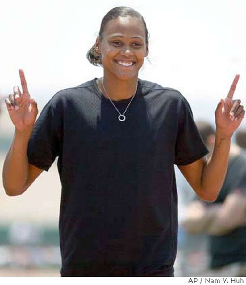 U.S. sprinter Marion Jones poses for a photo after she won the 100-meter race in 10.99 seconds at the track and field invitational meet, Saturday, May 22, 2004, Carson, Calif. (AP Photo/ Nam Y. Huh) Photo: NAM Y HUH