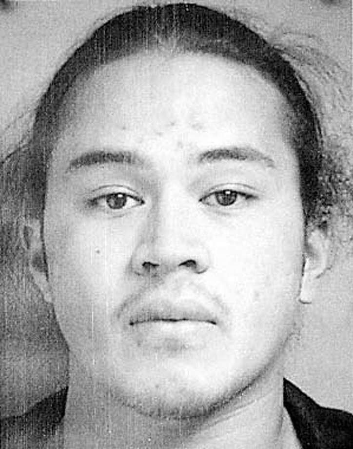 Bank robbery and murder suspect Seti Scanlan, of Mountain View, Calif., shown in this undated photo released by the police Sunday, Nov. 3, 2002, is considered armed and dangerous by authorities. Burlingame, Calif. police believe Scanlan, 24, is responsible for the death of Wells Fargo Bank manager Alice Martel, who was shot during an Oct. 11 robbery. (AP Photo/Police photo via San Mateo Times).
