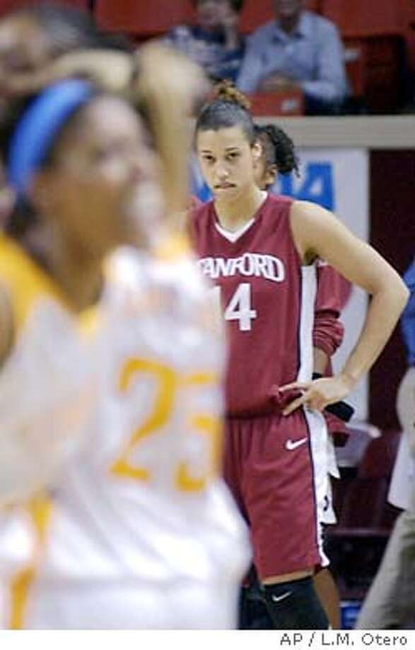 Stanford forward Nicole Powell (14) looks on as the Tennessee team celebrates winning the game 62-60 at the NCAA Midwest Regional final in Norman, Okla., Tuesday, March 30, 2004. On the right is Stanford Kristen Newlin. (AP Photo/L.M. Otero) Photo: L.M. OTERO
