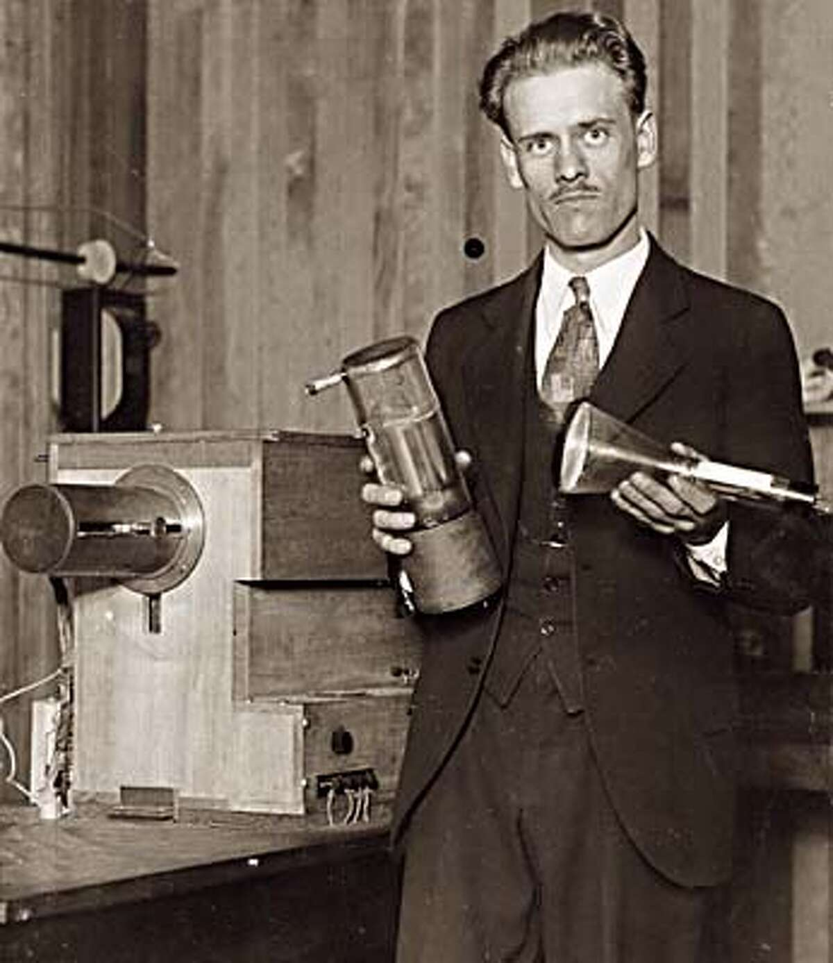 Philo Farnsworth, photographed by The Chronicle showing off his invention for the first time, didn't hold on to his patents, selling them to RCA Victor for $1 million in 1939. Chronicle Photo, 1928