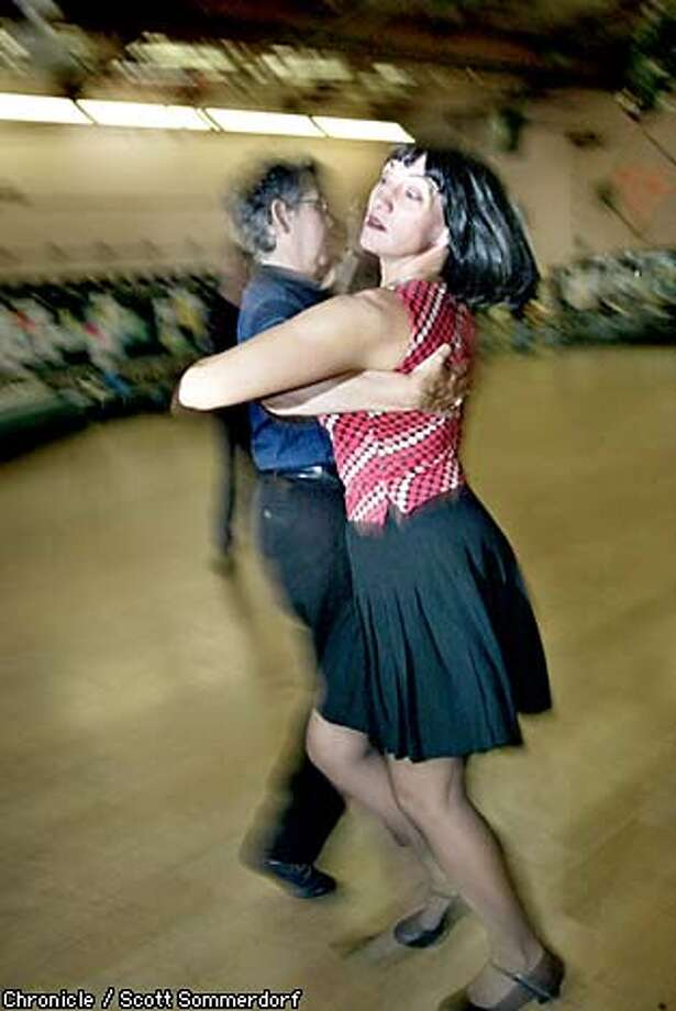 At the Allegro Ballroom in Emeryville, Barbara Zoloth of San Rafael (left) rehearses the tango with Zoe Balfour of Oakland in preparation for the Gay Games in Sydney. Chronicle photo by Scott Sommerdorf