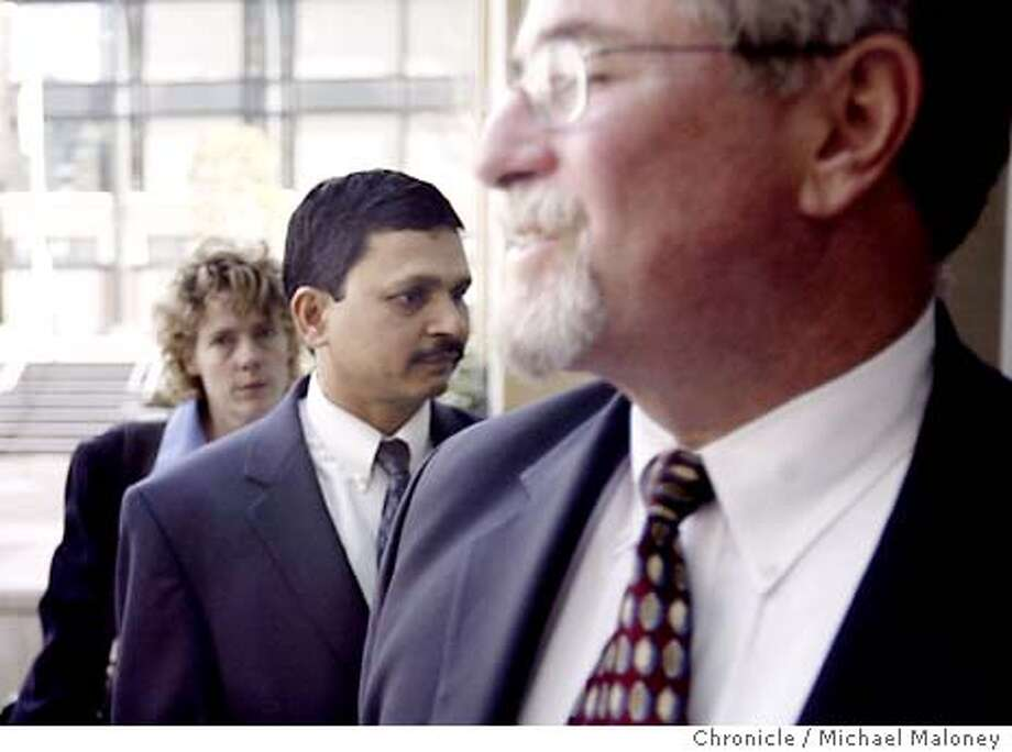 Prasad Lakireddy (center) arrives at the Federal Building in Oakland with his lawyer Paul Wolf (right).  Three protesters stood outside the Oakland Federal Building to voice their outrage as the latest in the clan of Berkeley tycoon Lakireddy Bali Reddy is sentenced.  Today, Prasad Lakireddy might NOT get any jail time as part of a plea agreement when he is formally sentenced. His father, the landlord, was sentenced to prison for smuggling teenage girls for sex and work. Photo by Michael Maloney / CHRONICLE Photo: Michael Maloney