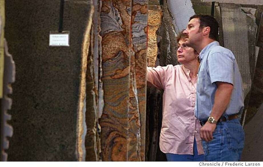 ; Customer Douglas Peirano and Linda Day of Pleasent Hill pick out rock for their kitchen at Alpha Granite and Marble in San Leandro. They have a huge showroom of slabs of countertop lined up. City:� 3/10/04, in San Leandro, CA. Frederic Larson/The Chronicle; Photo: Frederic Larson