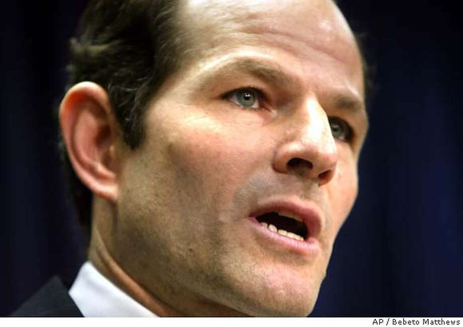 Attorney General Eliot Spitzer speaks during a press conference in New York, Monday May 24, 2004. Eliot announced that former New York Stock Exchange (NYSE) chief Richard Grasso would be sued over his excessive pay package. (AP Photo/Bebeto Matthews) Photo: BEBETO MATTHEWS