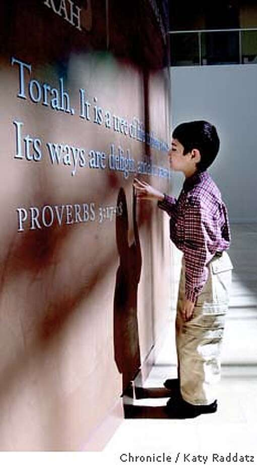 "SHOWN: Ibrahim Ghali, 6 years old, the son of Souleiman Ghali, who is the president of the Islamic Society of San Francisco, pauses outside the meeting room to read the quote from the Torah on the big wall of quotes from several religions. The quote is: ""It is a tree of life to those who hold fast to it. Its ways are delight, and all its paths are peace."" The Islamic Society of San Francisco invites people to participate with Christians, Muslims, and Jews about our Abrahamic Traditions: ""Living Your Faith: Jews, Christians, and Muslims in Conversation."" San Francisco Jewish Community Center. Katy Raddatz / The Chronicle Photo: Katy Raddatz"