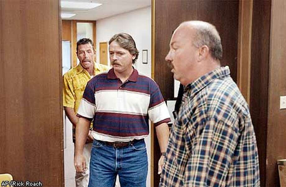 From front, Eric Berger, Brett Warder and Tim Fisher enter Judge William Harrison's Solano County, Calif., Superior Court room Thursday, Sept. 5, 2002. The three claim they had an oral agreement Jay Arsenault to split any proceeds from a baseball worth an estimated $1 million. Arsenault, a carpenter from Vacaville, Calif., caught San Francisco Giant's Barry Bonds' 600th homerun on Aug. 9th. (AP Photo/The Vacaville Reporter, Rick Roach) Photo: RICK ROACH