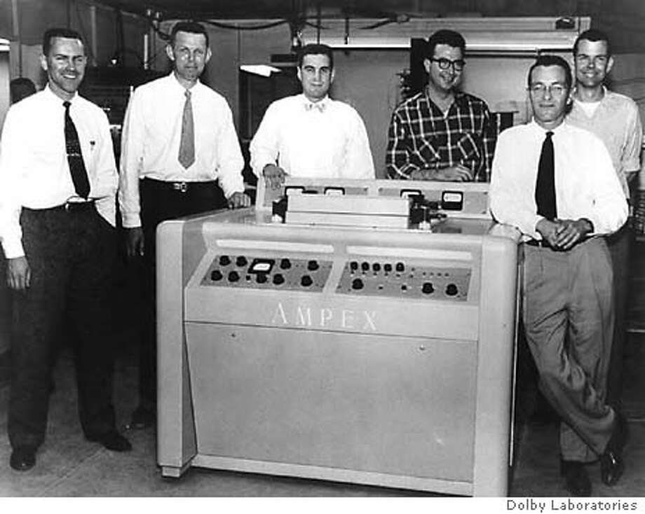 Ray Dolby (third from left) and other Ampex engineers with an early recorder in 1956. Dolby Laboratories file photo