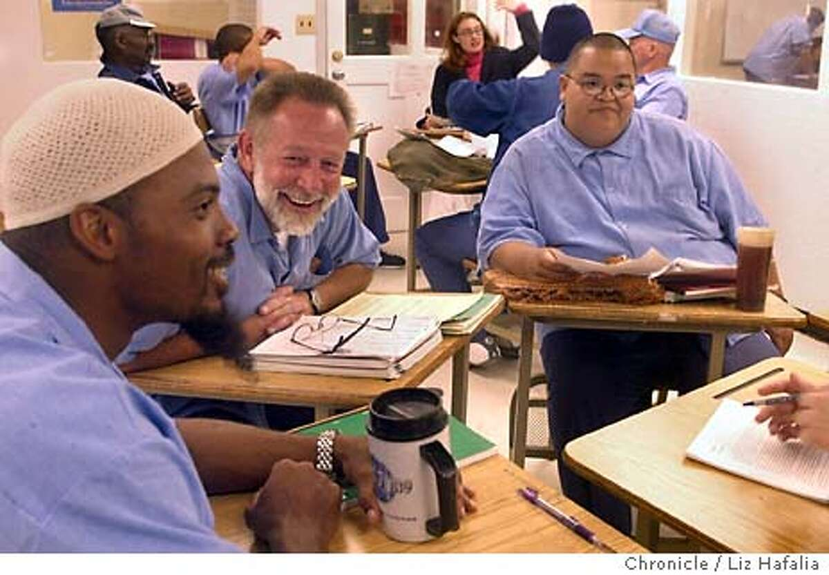 left to right--Inmates Abdul Waahid, Chuck Hopple, and Henry Frank, discussing George Orwell's writings in an English 101 class at San Quentin prison taught by a teacher and teacher aides from San Francisco State University. Photo taken on 03/04/04 in Larkspur, CA. Photo By LIZ HAFALIA / The San Francisco Chronicle