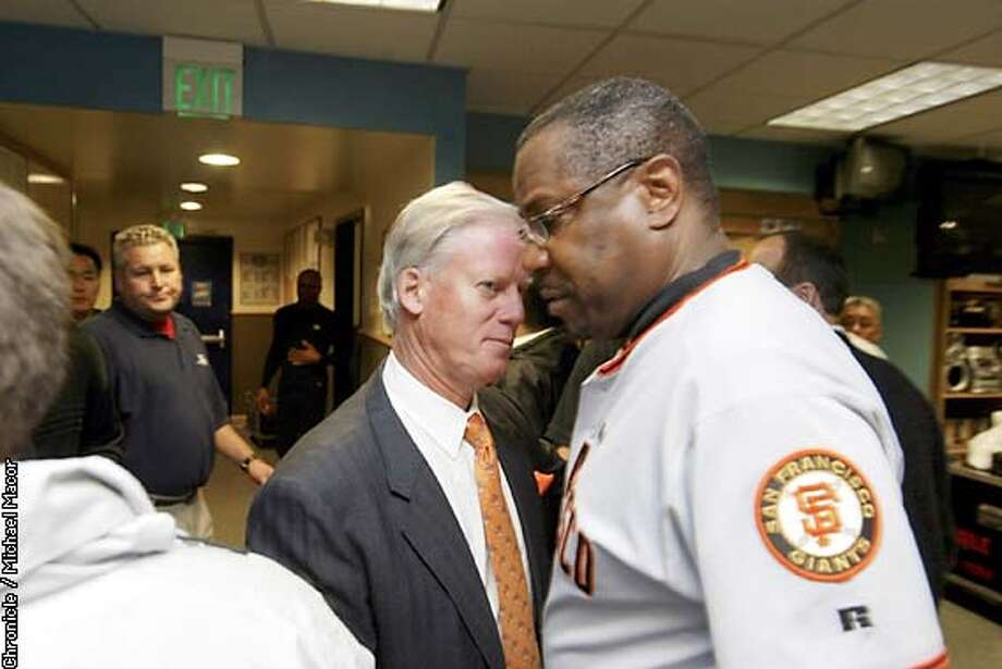 GIANTS69-C-27OCT02-SP-MAC---Giants manager Dusty Baker and Peter McGowan in the clubhouse after the game. The San Francisco Giants play the Anaheim Angels in Games 7 of the World Series at Edison Field in Anaheim, Ca., October 27, 2002. Michael Macor/San Francisco Chronicle