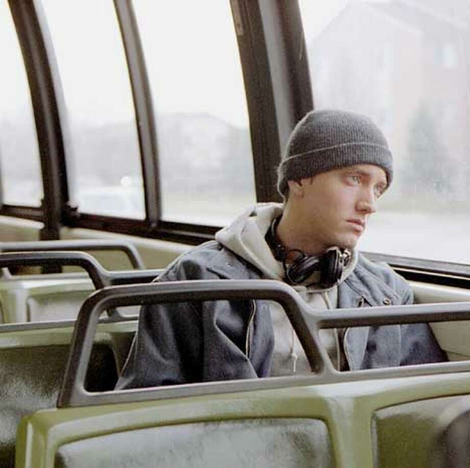 "Jimmy ""Rabbit Smith Jr., played by rapper Eminem, rides the bus to his factory job, in this scene from the movie ""8 Mile."" The rap star makes his big screen debut in the semi-autobiographical film that closely represents a period in the rapper's life growing up in the Detroit area. (Universal Studios, Eli Reed) Photo: ELI REED"