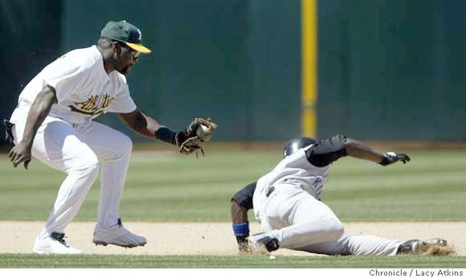 Oakland Athletics Mark Mclemore tags Kansas City Royals Angel Berroa out in a fielders choice run down in the seventh inning, May 23, 2004, in Oakland.  Oakland Athletics defeat the Kansas City Royals May 23, 2004.in Oakland, 3-2 in the 10th inning.  Chronicle photo by Lacy Atkins Photo: LACY ATKINS