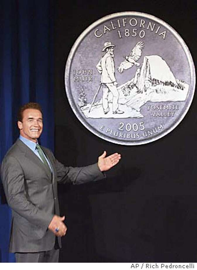California Gov. Arnold Schwarzenegger displays the final choice for the , in Sacramento, Calif., Monday, March 29, 2004. The winning entry, designed by Los Angeles artist Garrett Burke, shows Yosemite National Park's Half Dome mountain, conservationist John Muir, and a California condor in flight. The quarter is scheduled to be minted beginning in January. (AP Photo/Rich Pedroncelli) Photo: RICH PEDRONCELLI