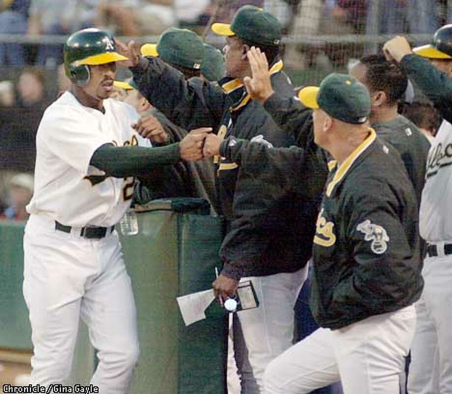 Terrence Long is welcomed back to the dugout after scoring in the first inning of the Oakland Athletics vs. Kansas City Royals in Oakland, Ca. September 4, 2002. Gina Gayle/San Francisco Chronicle Photo: Gina Gayle