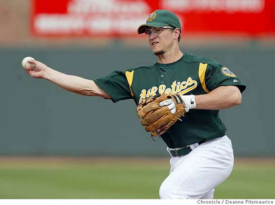 Mark Ellis makes a play at first as the Oakland Athletics play the Arizona Diamondbacks at spring training in Phoenix, Arizona.  CHRONICLE PHOTO BY DEANNE FITZMAURICE Photo: Deanne Fitzmaurice
