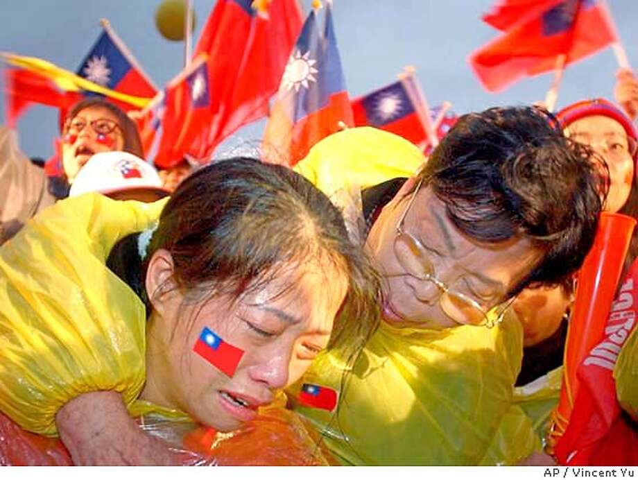A supporter of opposition candidate Lien Chan breaks into tears at a massive election protest in Taipei, Taiwan Saturday March 27, 2004.Organizers were expecting half a million demonstrators to gather and call for a recount of the vote in last weekend's disputed presidential election, and an independent investigation into the shooting that lightly wounded President Chen Shui-bian just hours before he narrowly won the election. (AP Photo/Vincent Yu) #######0421695600 Photo: VINCENT YU