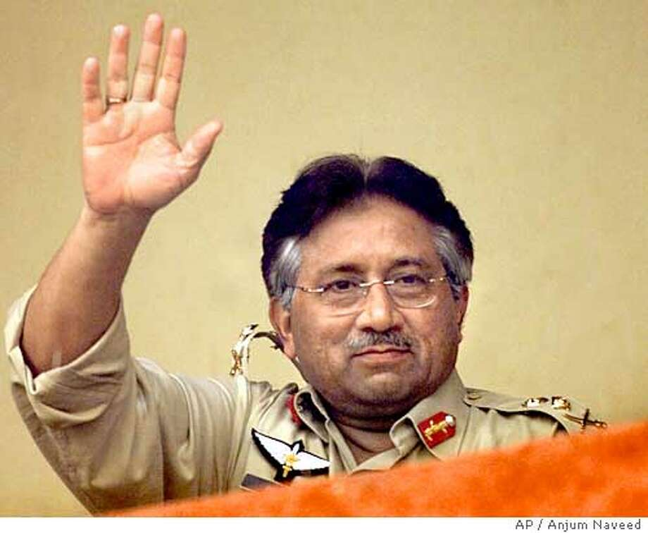 Pakistani President Gen. Pervez Musharraf waves to the crowd during the second one-day international between Pakistan and India in Rawalpindi, Pakistan on Tuesday, March 16, 2004. (AP Photo/Anjum Naveed) Mian Imran Massood, the Punjab's education minister, visits Lahore's Cluster Center, which can house 5,000 students. Photo: ANJUM NAVEED