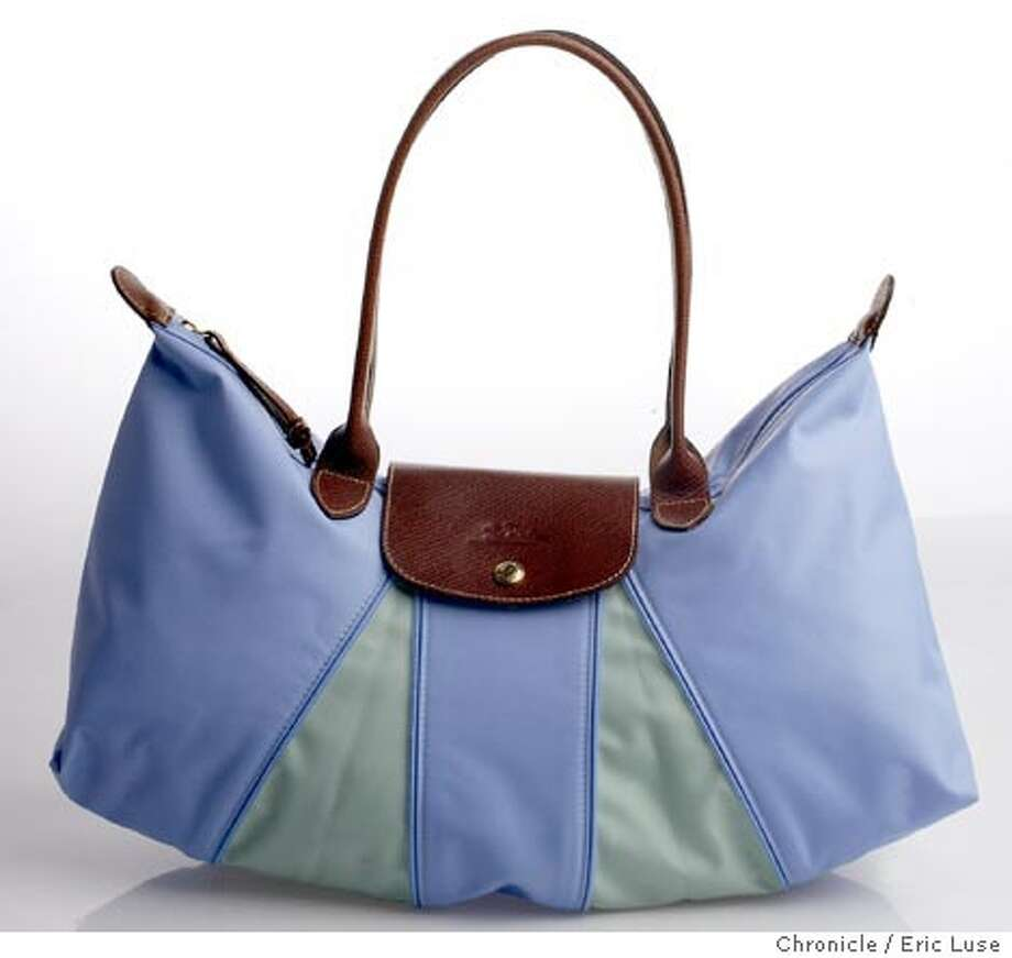 Tres Francais: Longchamp's Pliages bag zips and folds down to a square, $195, Longchamp, 114 Grant Ave., S.F.; (415) 362-7971 Photo: Eric Luse