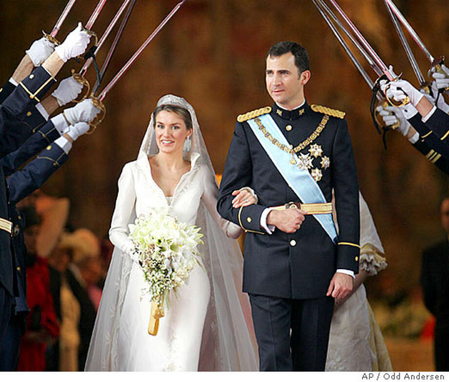 Spanish Crown Prince Felipe, 36, married Letizia Ortiz, a former TV anchorwoman, in a Madrid ceremony Saturday. Associated Press photo by Odd Andersen