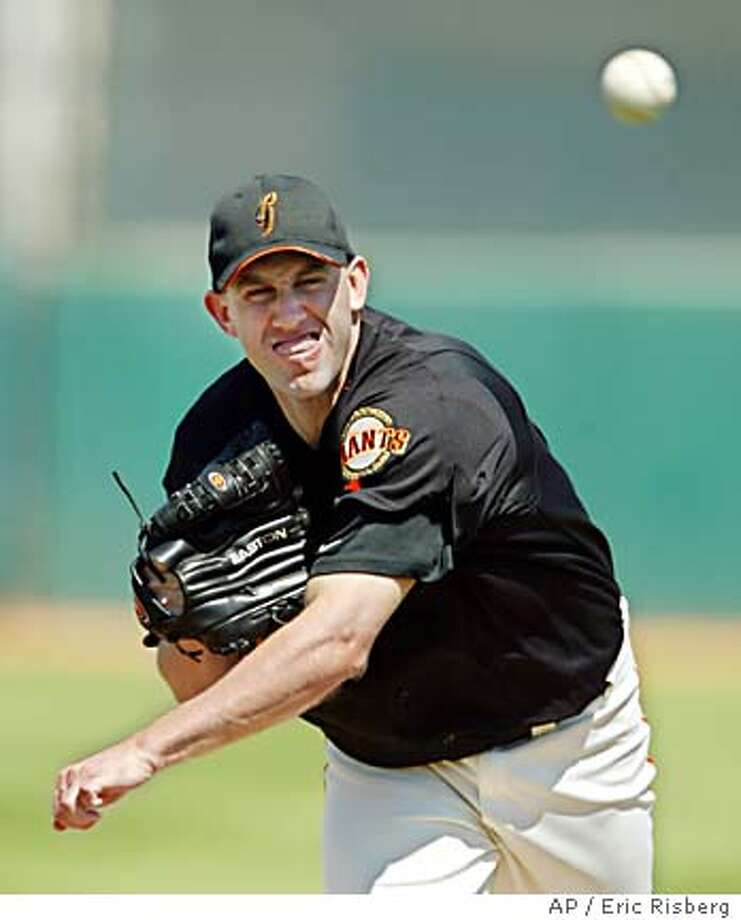 San Francisco Giants' starting pitcher Kirk Rueter throws a warm up pitch before facing the Anaheim Angels durin the first inning of their spring training game in Scottsdale, Ariz., Sunday March 28, 2004.(AP Photo/Eric Risberg) Photo: ERIC RISBERG
