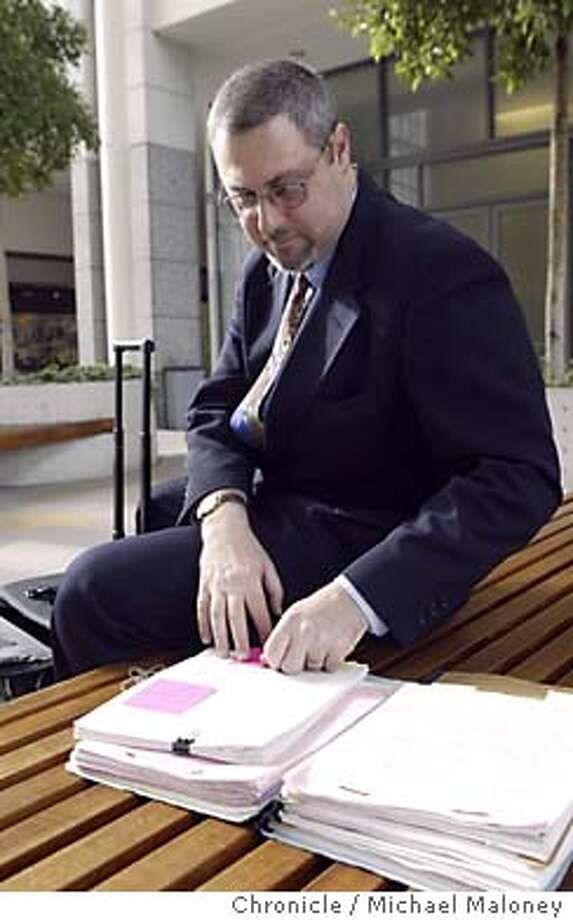 "Jeremy Smith is an attorney, who represents workers comp ""applicants,"" i.e. workers, as their cases go through the appeals process. Here he goes through some court briefs prior to a court hearing at the Elihu Harris State Office Building.  Photo by Michael Maloney / CHRONICLE Photo: Michael Maloney"