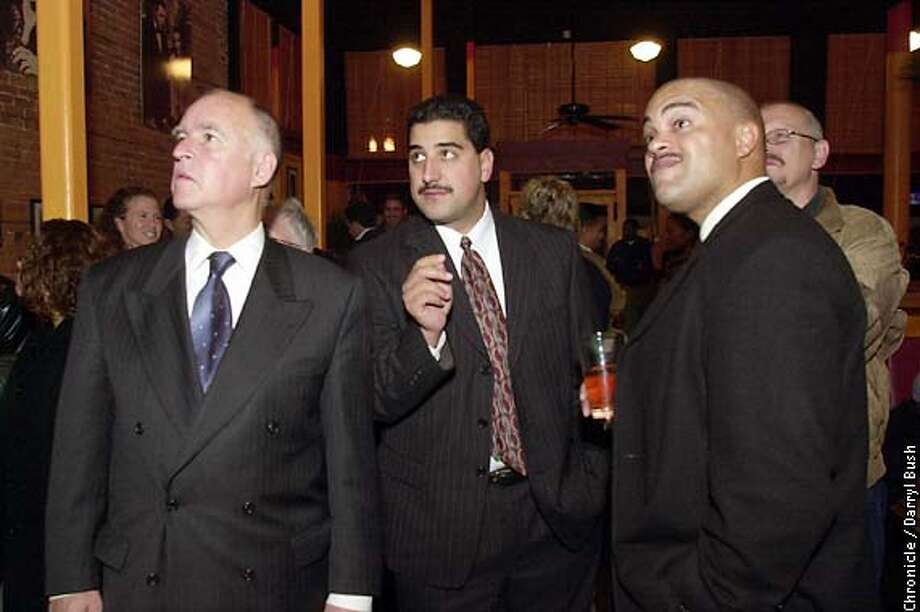 Oakland Mayor Jerry Brown, left, and Browns's chief of staff, Paul J. Figueroa, center, Police Chief Richard Word, right, watch results on Oakland's city measures at Oakland's Rex restaurant. CHRONICLE PHOTO BY DARRYL BUSH Photo: Darryl Bush