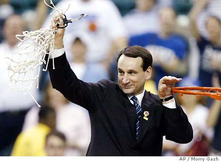 Duke coach Mike Krzyzewski holds the net after cutting it down after Duke defeated Xavier 66-63 in the NCAA Atlanta regional final at the Georgia Dome in Atlanta, Sunday March 28, 2004. (AP Photo/Morry Gash) Mike Krzyzewski's Duke team takes on UConn again. Photo: MORRY GASH