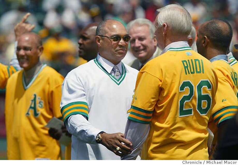 Reggie greets some old teammates like Joe Rudi during the festivities. Reggie Jackson became the third Oakland Athletic to have his number retired. The Oakland Athletics vs. Kansas City Royals. event on 5/22/04 in Oakland Michael Macor / San Francisco Chronicle Photo: Michael Macor