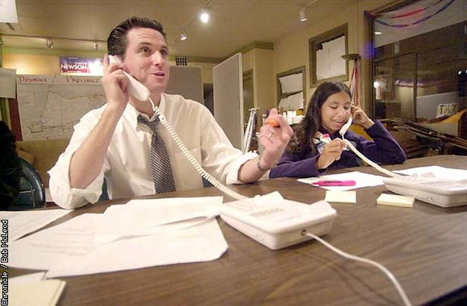 NEWSOMEb-C-11NOV02-MN-BM  Gavin Newsome works the phones with 13 year old Angela Silver-Lima at Newsome HQ on Filmore and Union in SF.  chronicle photo by bob mcleod
