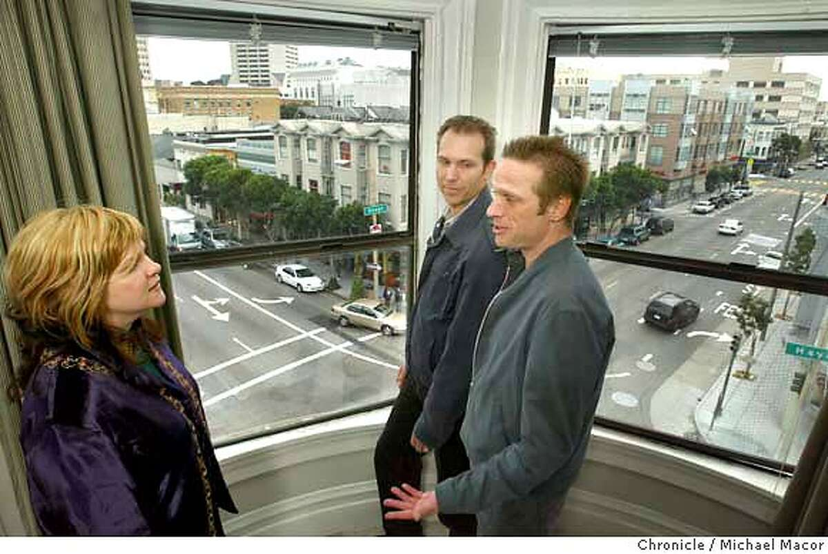 Leigh Stackpole, merchant and legislation supporter, Peter Cohen, co-author of the legislation and Ed Bedard, also a co-author, above the intersection of Hayes and Gough Sts. in the heart of the Hayes Valley, looking out of a corner window of the Hayes Valley Inn. With the San Francisco Board of Supervisors on the verge of giving final approval to legislation banning new chain stores in a four-block area of Hayes Valley, we visit the area to find out what's so special about the place. event on 3/26/04 in Livermore Michael Macor / San Francisco Chronicle