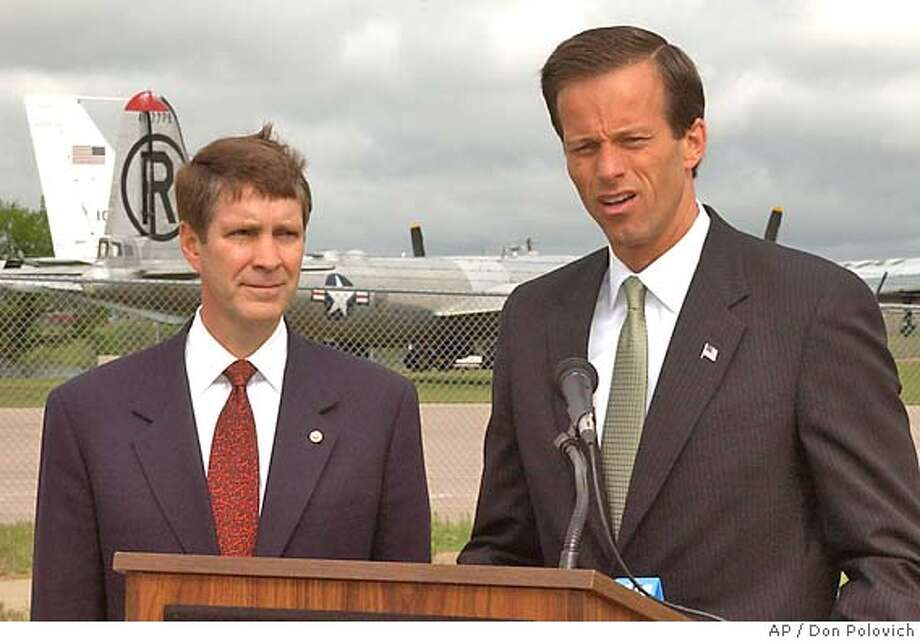 Senate Majority Leader Bill Frist, left, R-Tenn., and Senate candidate John Thune speak at a news conference held near the South Dakota Air & Space Museum in Box Elder, S.D., following at tour of Ellsworth Air Force Base Saturday, May 22, 2004.. Thune is on a campaign swing across South Dakota. Frist is campaigning for the defeat of his Democratic counterpart, South Dakota's Tom Daschle. (AP Photo/Rapid City Journal, Don Polovich) Photo: DON POLOVICH