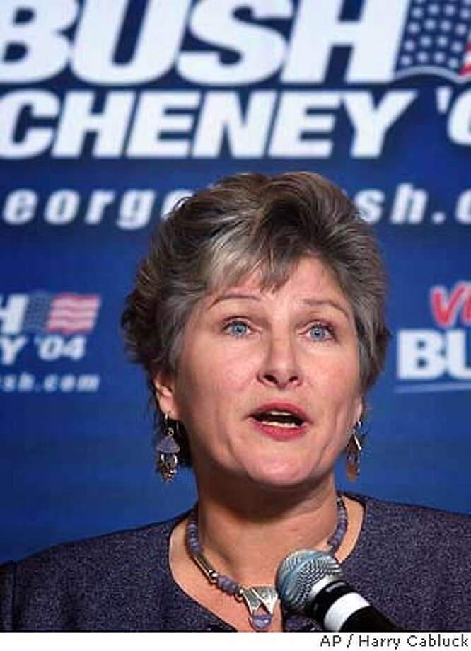 ** FILE ** Former White House counselor Karen Hughes announces the Bush campaign's Texas leadership team during a news conference in this Dec. 16, 2003, file photo in Austin, Texas. Hughes is one of a relatively small group of counsellors helping to guide the most expensive, and possibly the most businesslike, presidential campaign in history. (AP Photo/Harry Cabluck, File) Photo: HARRY CABLUCK