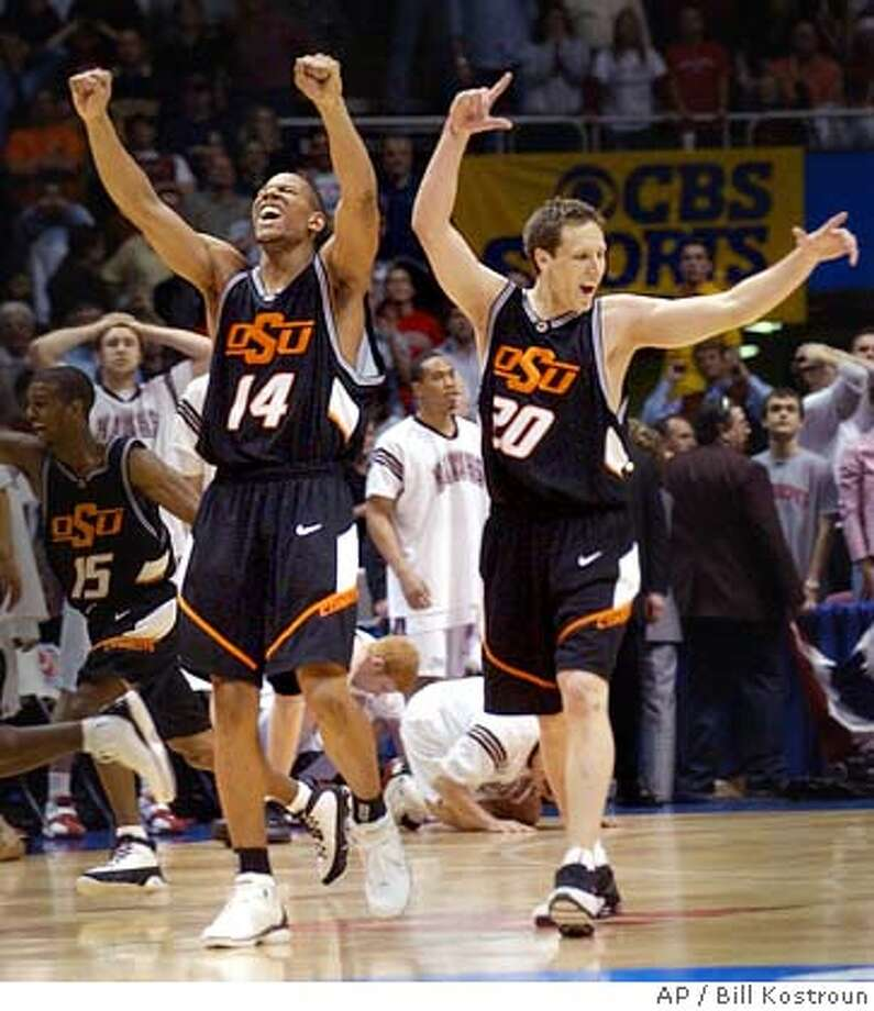Oklahoma State's John Lucas (15) and teammates Joey Graham (14) and Daniel Bobik (20) celebrate their 64-62 victory over Saint Joseph's at the NCAA Regional final in East Rutherford, N.J., Saturday, March 27, 2004. (AP Photo/Bill Kostroun) Photo: BILL KOSTROUN