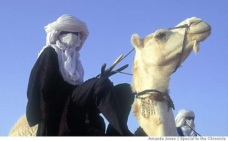 A Tuareg man and his companion on camelback in the Sahel. Photo by Amanda Jones special to the Chronicle