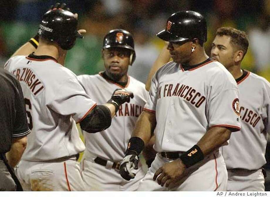A.J. Pierzynski was the man of the hour as his grand slam led the Giants to their third straight win. Associated Press photo by Andres Leighton