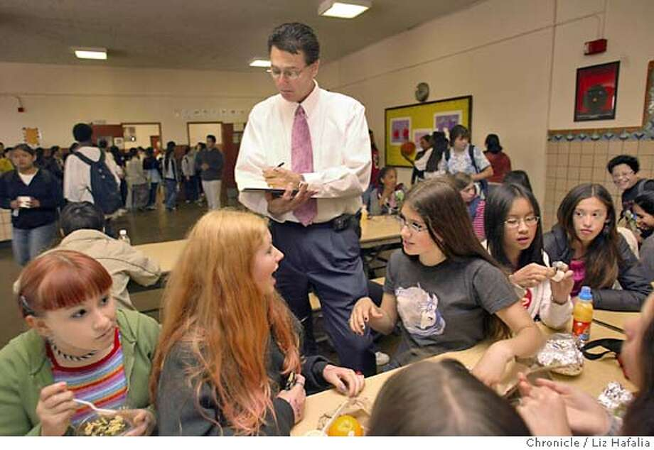 Ed Wilkins, interim director of the student nutrition for San Francisco Unified school district, finding out what students at Aptos Middle school think of the cafeteria food during the lunch period. Left to right on bottom--Seventh graders Elina Ansary, Kendall Owings, Liliana Silva, Lily Ling. Shot on 5/11/04 in San Francisco. LIZ HAFALIA / The Chronicle Photo: LIZ HAFALIA