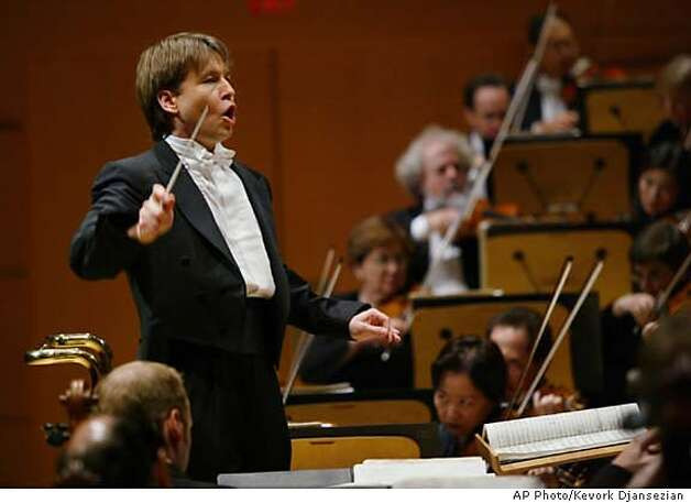 Los Angeles Philharmonic Music Director Esa-Pekka Salonen leads the orchestra during a grand opening concert gala at the new Walt Disney Concert Hall in Los Angeles, Thursday, Oct. 23, 2003. (AP Photo/Kevork Djansezian) ALSO RAN 11/03/03 CAT Photo: KEVORK DJANSEZIAN