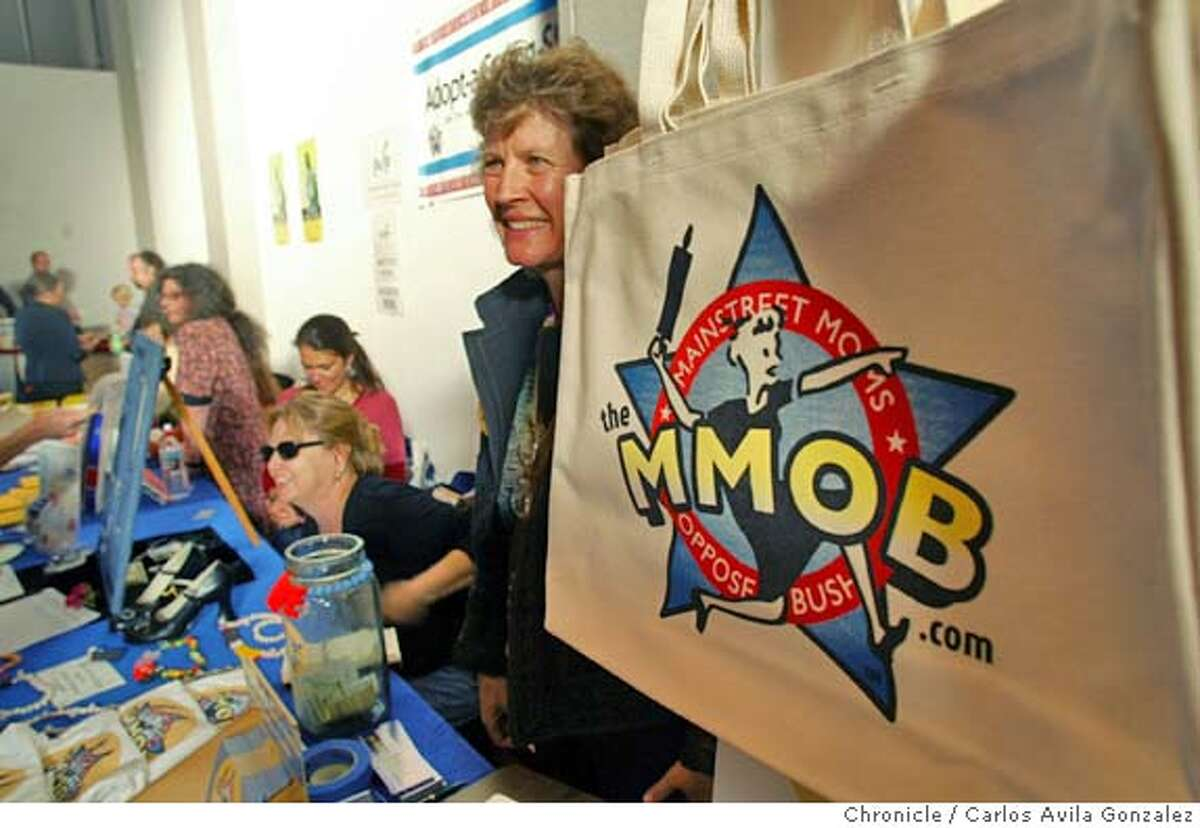 Rachel Johnson, of Bolinas, works the MMOB booth (Mainstream Moms Oppose Bush) at Rally the Vote -- a major event to organize the estimated 50 million eligible women who did not vote in the last election -- The event took place at Fort Mason on Tuesday, May 18, 2004. The organizer is Joan Blades, who founded MoveOn.Org, which has become a leading 527 (independent expenditure) group aiming to organize voters in 2004. Other women's groups who will participate include MOB (Mothers Opposed to Bush) and a variety of other groups -- story will talk about if women (particularly moms) see this election differently because of the war... Photo taken on 05/18/04 in San Francisco, Ca. Photo By Carlos Avila Gonzalez / The San Francisco Chronicle