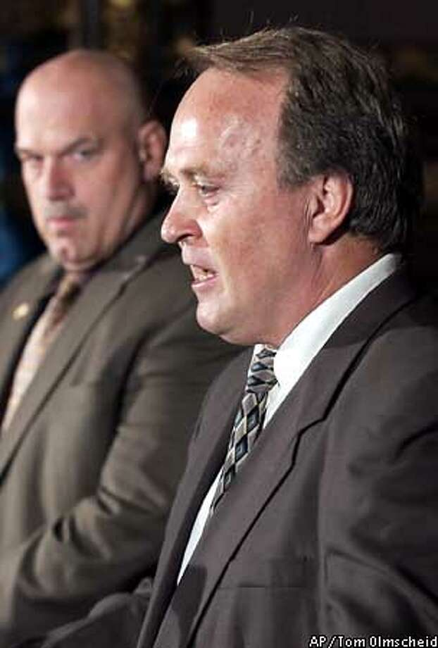 Minnesota Planning Commissiner Dean Barkley, right, addresses the press after being named U.S. Senator by Gov. Jesse Ventura, left, to fillout the late Sen. Paul Wellstone term during a news conference at the State Capitol Nov. 4, 2002 in St. Paul, Minn.(AP Photo/Tom Olmscheid) Photo: TOM OLMSCHEID