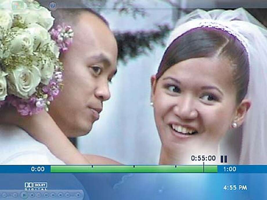 Newlyweds Jeffrey and Shirley Dollente of Antioch celebrate their marriage in this scene from a home video that was transferred to a DVD using Apple's iDVD program. Photo courtesy of Benny Evangelista
