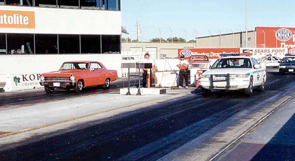 Young drivers get a chance to race the police in the Top the Cops event. on 3/22/04 in San Francisco. / HO