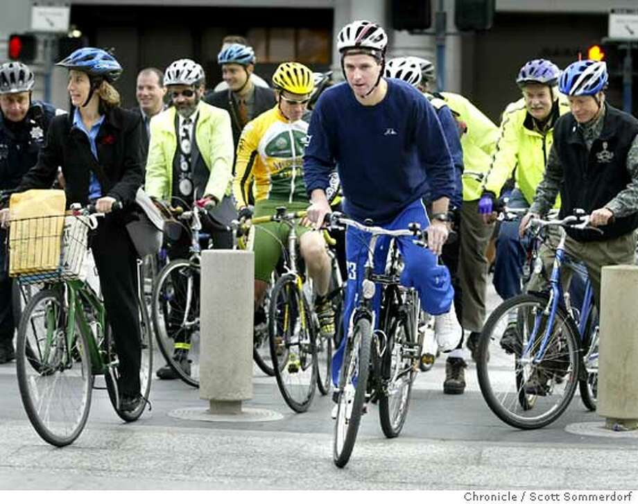 San Francisco Mayor Gavin Newsom leads a pack of bicyclists from the Ferry Building for a ride up Market Street on Bike to Work Day. Chronicle photo by Scott Sommerdorf
