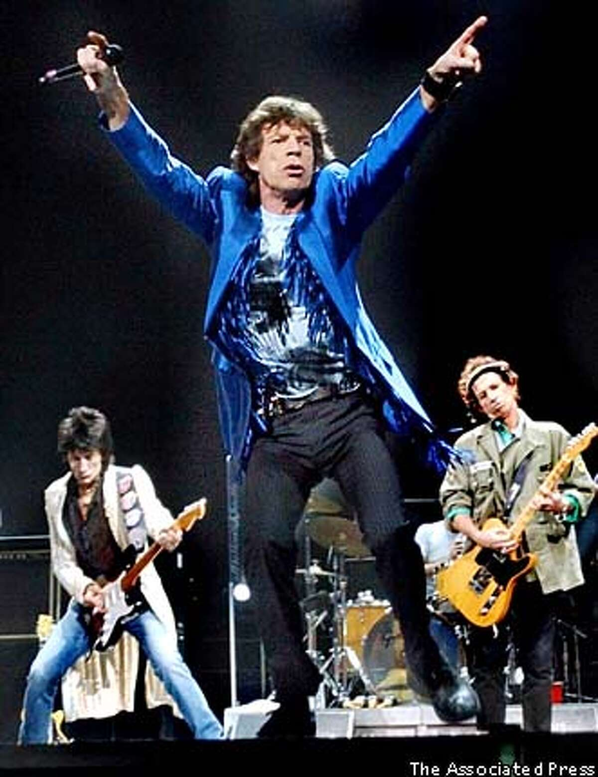 The Rolling Stones, (left to right) guitarist Ron Wood, front man Mick Jagger and guitarist Keith Richards, performed Oct. 22 in Sunrise, Fla. South Florida Sun-Sentinel photo by Robert Duyos via Associated Press