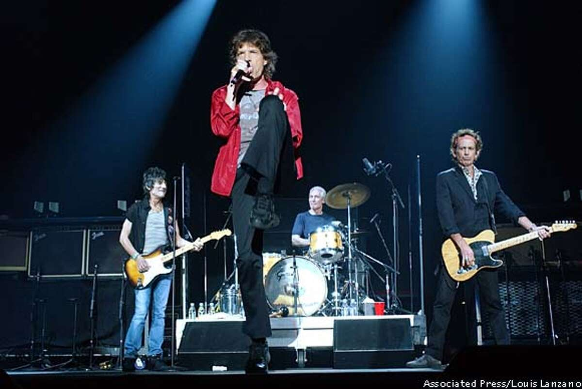 Ron Wood (from left), Mick Jagger, Charlie Watts and Keith Richards during the Sept. 30 Licks Tour stop in New York: They have no plan to quit performing. Associated Press photo by Louis Lanzano