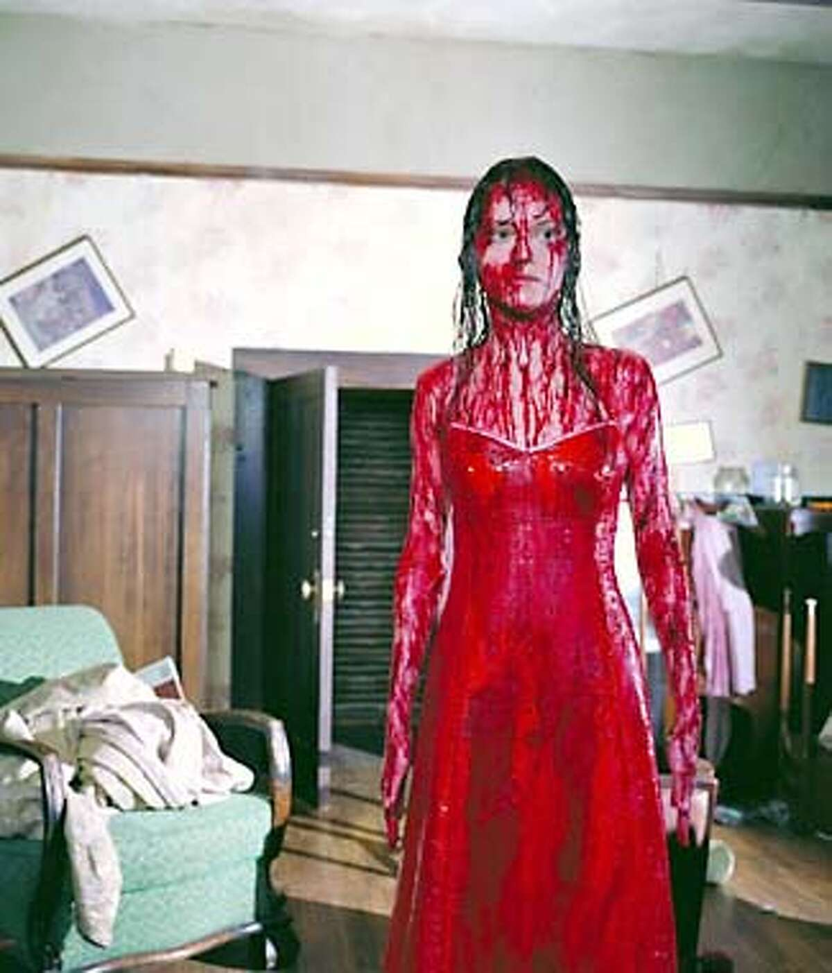 CARRIE -- NBC Movie -- Pictured: Angela Bettis as Carrie White -- NBC Photo by: Paul Michaud Airdate: Monday, November 4 on NBC (9-11p.m. ET) Size: 686920 (bytes) Posted: 10/22/02