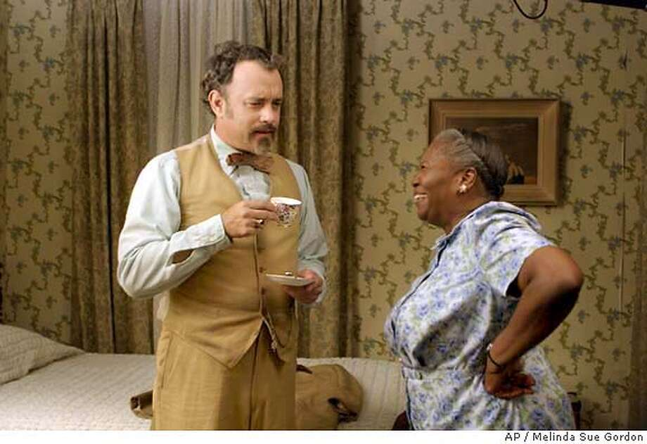 "When Goldthwait Higginson Dorr, Ph.D. ( Tom Hanks, left), concocts the plot for the perfect heist, he rents a room from unsuspecting church lady Mrs. Munson (Irma P. Hall, right), in the hilarious comedy, ""Ladykillers."" (AP Photo/Melinda Sue Gordon) Photo: MELINDA SUE GORDON"