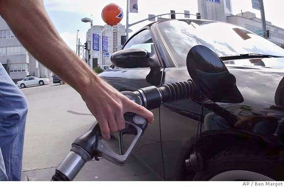 A man pumps gas Tuesday, May 18, 2004, in San Francisco. As gas prices in California jumped to new highs, the state's two senators Tuesday called on the Bush administration to tap the country's oil reserves to bring prices down. (AP Photo/Ben Margot) Photo: BEN MARGOT