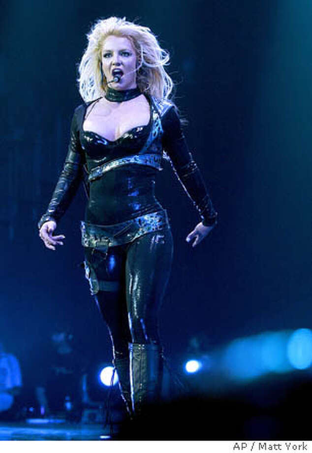 Britney Spears performs during the second show of her ' Onyx Hotel Tour ' March 3, 2004 at Glendale Arena in Glendale, Ariz. Spears will tour numerous cities in North America before visiting Europe, Latin America and Asia throughout 2004 as she promotes her multi platinum album 'In the Zone.' (AP Photo/Matt York) Photo: MATT YORK