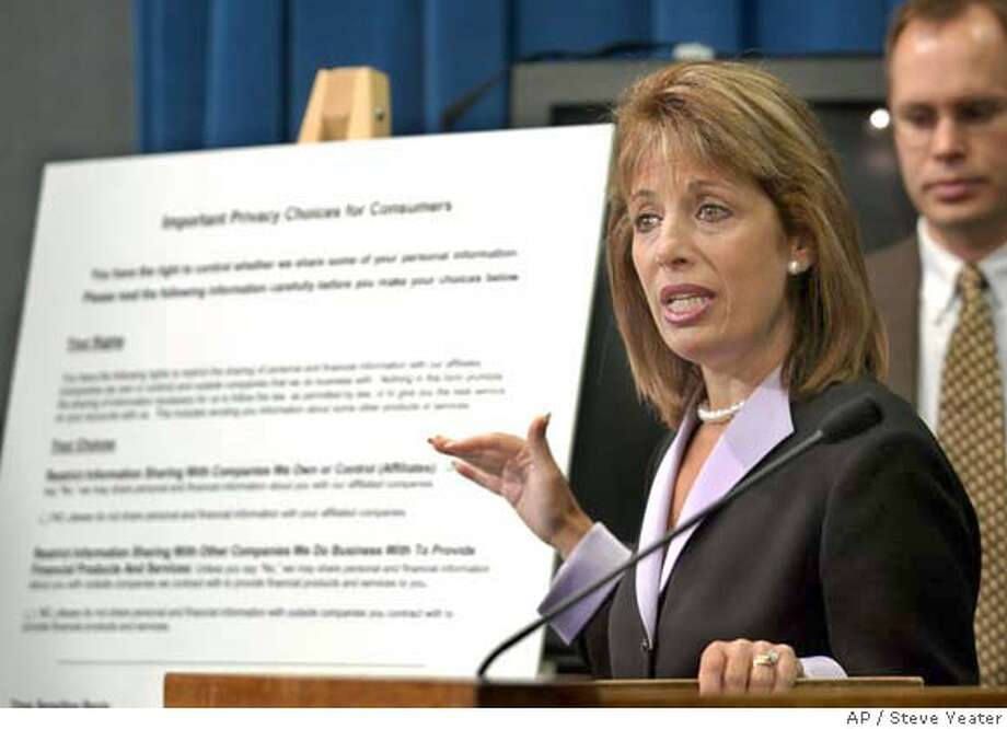 Sen. Jackie Speier, D-Daly City, outlines changes to her financial privacy Bill SB1 during a news conference at the Capitol in Sacramento, Calif., on Thursday, Aug. 14, 2003. Opponents have abandoned their fight against the bill which would stop businesses from selling personal financial information because of the threat of a much stronger ballot initiative next year that so far appears to be popular among voters. (AP Photo/Steve Yeater)  ALSO RAN 1/20/2004 CAT Photo: STEVE YEATER