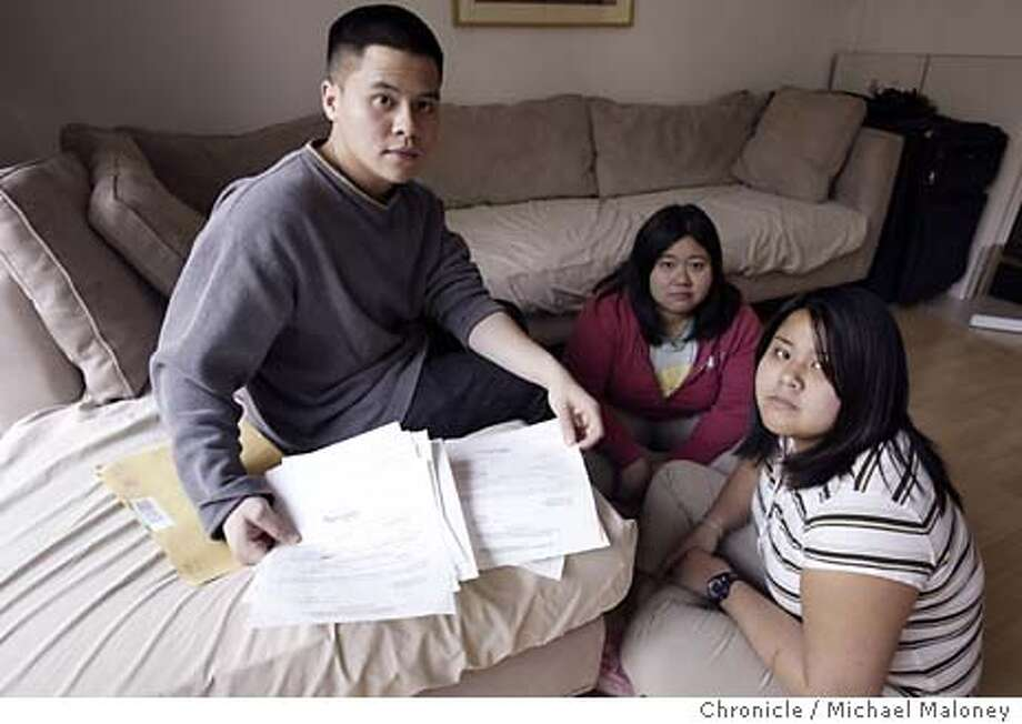 From left, Dave Cuevas, Donna Cuevas and Dominique Cuevas look over the deportation papers in the living room of their parent's Fremont home.  The Cuevas family of Fremont has lived illegally in the East Bay since 1996 and is now on final order of deportation. They are to leave the country and return to the Philippines April 7th.  Delfin Cuevas arrived in the United States in 1984 on a visitor's visa. His wife, Angelita, and their toddler children followed in 1985. The adult Cuevas children -- Dale, 23, Donna, 24, and Dominique, 20 - - say they were not aware of their undocumented status until deportation papers arrived in December. They speak only English and remember little about the Philippines. Photo by Michael Maloney / The Chronicle Photo: Michael Maloney