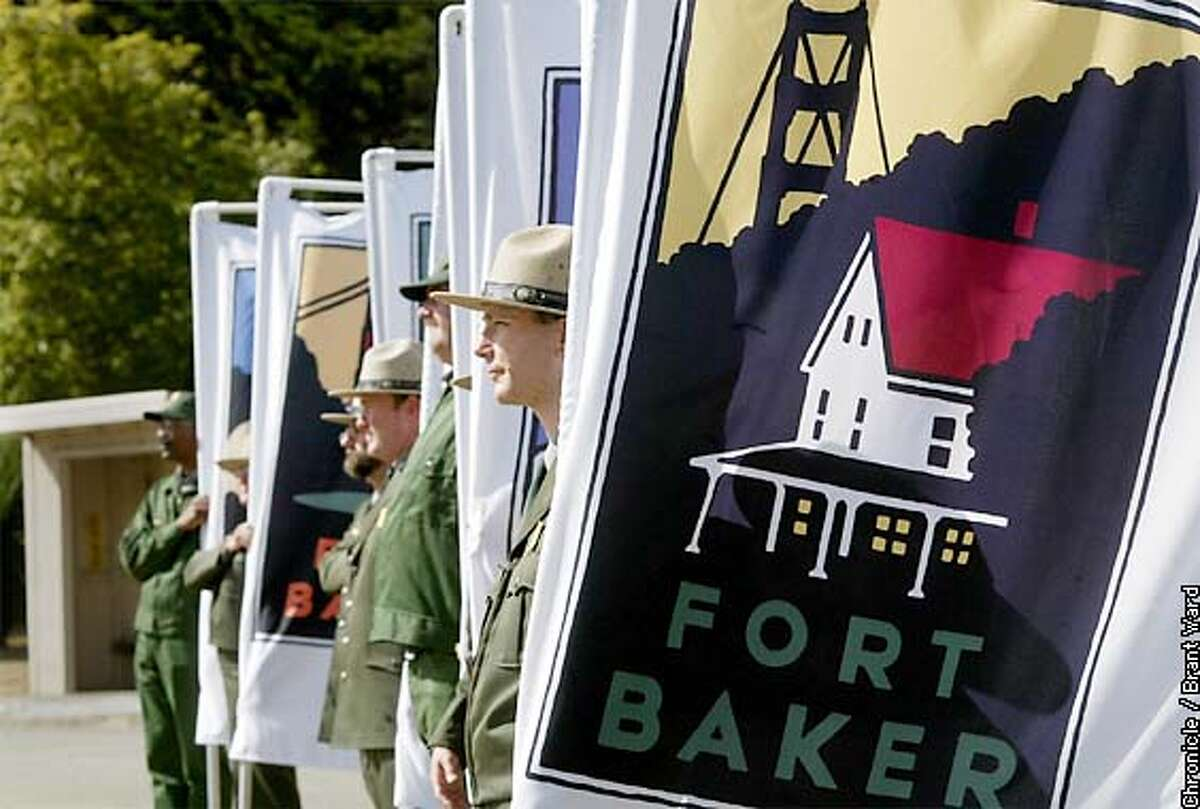 At the ceremony marking Fort Baker's inclusion into the GGNRA, National Park ranger Paul Bignardi held the newest flag in the group. By Brant Ward/Chronicle